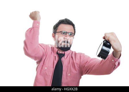 Angry young man holding alarm clock - Stock Photo