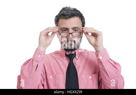 Man taking an eye exam and wearing glasses - Stock Photo