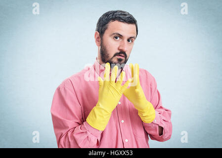 Cleaning man putting latex glove and prepare to clean house isolated on white background - Stock Photo