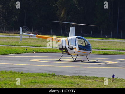Robinson R22 (C-FDAZ) Light two seat helicopter at Qualicum airport on Vancouver island, BC. Canada.  SCO 11,598. - Stock Photo