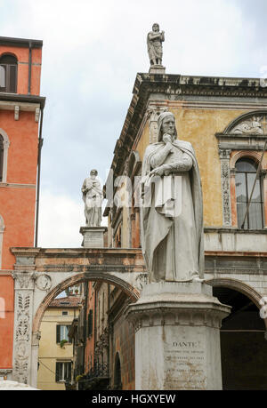 The statue of the famous italian poet Dante Alighieri in Lords Square at Verona on Italy - Stock Photo