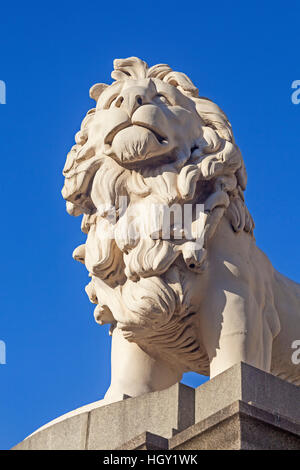 London, Westminster  The coade stone 'South Bank Lion' standing at the southern end of Westminster Bridge - Stock Photo