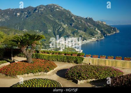 Flower garden of Villa Rufolo over looking the Amalfi Coast and the Gulf of Salerno, Ravello, Campania, Italy - Stock Photo