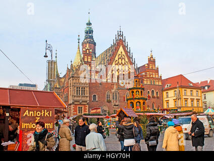 The Old Town Hall looks like the castle from the fairy tale, especially surrounded by Christmas Fair - Stock Photo