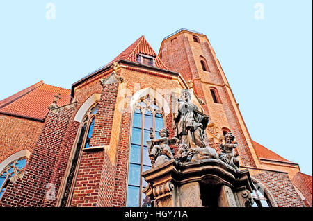 The figure of St John of Nepomuk, located in front of the Church of St Matthias the Apostle - Stock Photo
