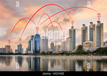 Concept of 5G network connection illustrated by smart city and buildings. - Stock Photo