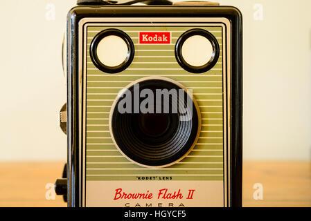 Classic Kodak Box Brownie camera on polished wood top - Stock Photo