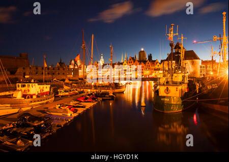 Evening on the waterfront of Gdansk Poland looking across the Motława River to Główne Miasto (Main Town) - Stock Photo
