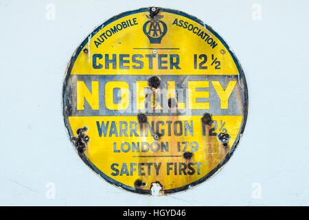 Old Automobile Association road sign on wall in Norley Cheshire - Stock Photo