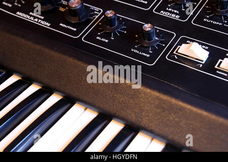Closeup of keyboard and controls of a retro analogue synthesizer - Stock Photo