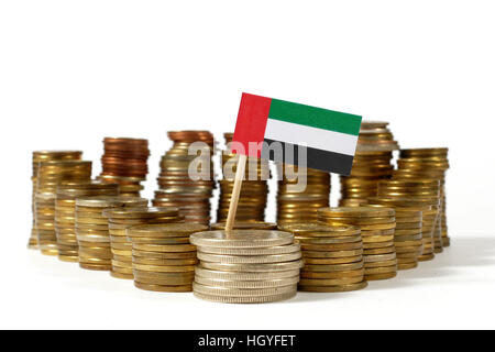 United Arab Emirates flag waving with stack of money coins - Stock Photo