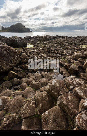 The Giant's Causeway is an area of about 40,000 interlocking basalt columns, the result of an ancient volcanic eruption. - Stock Photo