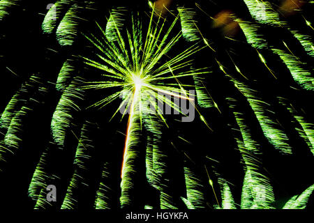 Green fireworks in night sky, Quebec, Canada - Stock Photo