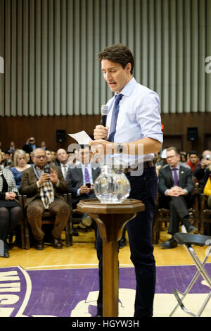 London, Ontario, Canada, 13th January, 2017. Justin Trudeau, Prime Minister of Canada, reads a note in a town hall - Stock Photo