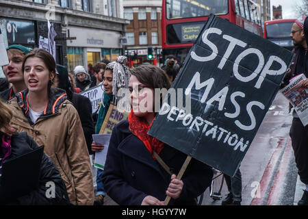 London, UK. 14th Jan, 2017. London, UK. 14th Jan, 2016. Protesters march to END the British government's mass deportation - Stock Photo