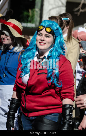 Calgary, Alberta, Canada - April 17 2015: Blue haired cosplayer at the Calgary Comic an Entertainment Expo Parade - Stock Photo
