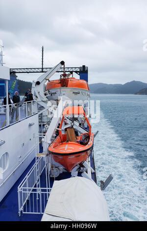 Lifeboats on the Kaiarahi Interislander ferry in New Zealand. - Stock Photo