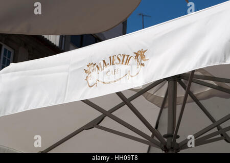 Porto: details of an outdoor umbrella of the Majestic Café, an historic café in Rua de Santa Catarina inaugurated - Stock Photo