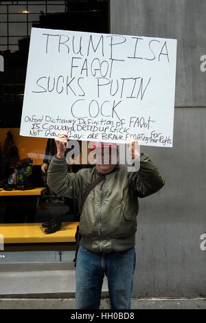 People protest outside Trump Tower in Manhattan as President Elect Donald Trump holds his first press conference - Stock Photo