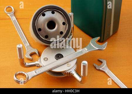 Oil filter wrench on wooden background closeup - Stock Photo