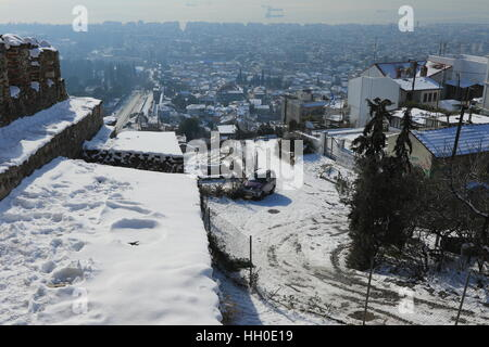 A view  of Thessaloniki and of its eastern Walls under snow, from the Trigono Tower in the city's Upper Town. - Stock Photo