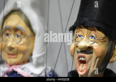 Old worlde wooden puppets in Prague at Christmas - Stock Photo