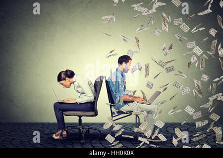 Employee compensation economy concept. Woman working on laptop sitting next to young  man under money rain. Pay - Stock Photo