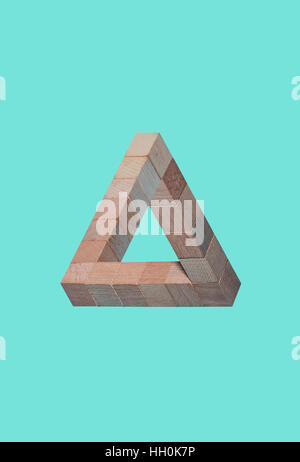 Penrose Triangle - Impossible shape - Building the impossible - Stock Photo