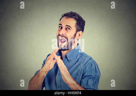 angry mad, furious man raising hands in air attack with karate chop isolated gray background. Negative emotion facial - Stock Photo