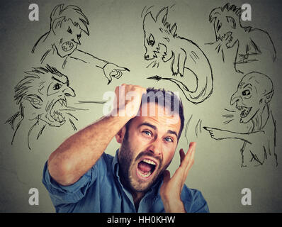Evil men pointing at stressed anxious guy. Desperate businessman frustrated screaming isolated gray background. - Stock Photo