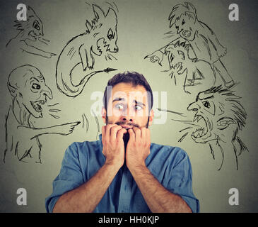 Bad evil men pointing at stressed man. Desperate scared businessman isolated on gray background. Human emotions - Stock Photo