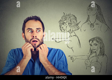 Bad evil women pointing at stressed anxious man. Human emotions face expression feelings perception. Relationship - Stock Photo
