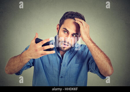 Closeup portrait, shocked man feeling head, surprised he is losing hair, receding hairline, bad news isolated on - Stock Photo