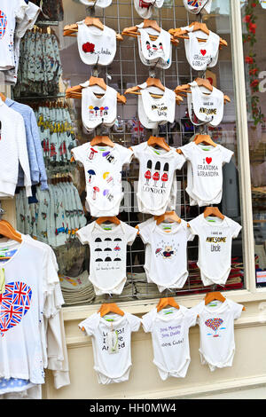 London. Portobello road. Store wit babies clothing for sale. - Stock Photo