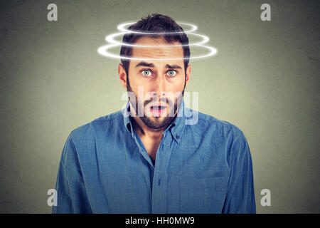 Head is spinning. Surprise astonished man. Closeup portrait man looking surprised in full disbelief wide open mouth - Stock Photo