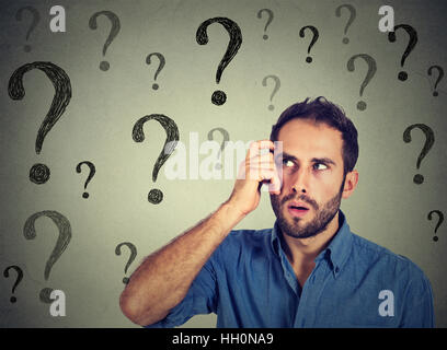 Thoughtful confused handsome man has too many questions and no answer - Stock Photo