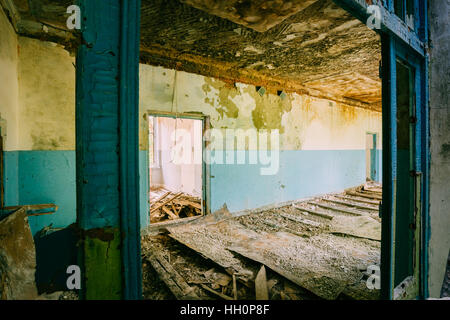 The Ruined Floor, Seiling Of Abandoned School After Chernobyl Disaster In Evacuation Zone. The Terrible Consequences - Stock Photo