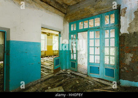 The Ruined Interior Of Abandoned School After Chernobyl Nuclear Disaster In Evacuation Zone. Consequences Of The - Stock Photo
