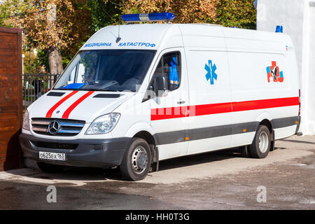 Ambulance car parked up in the street. Text in russian: 'Emergency Medicine' - Stock Photo