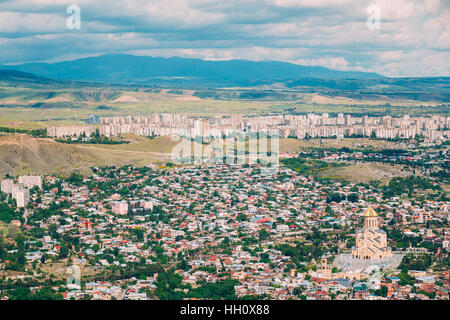 Tbilisi, Georgia. The Aerial Panoramic View Of Sameba Complex, Holy Trinity Cathedral Surrounded By Populous Private - Stock Photo