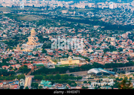 Tbilisi, Georgia. Evening Aerial Panoramic View Of Sameba Complex, Holy Trinity Cathedral Surrounded By Populous - Stock Photo