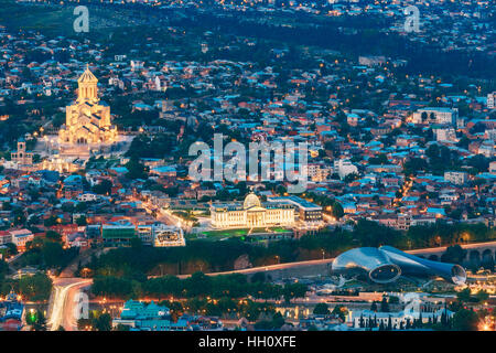 Tbilisi, Georgia. Scenic Aerial Cityscape With Famous Landmarks In Bright Illumination: Sameba Complex, Avlabar - Stock Photo