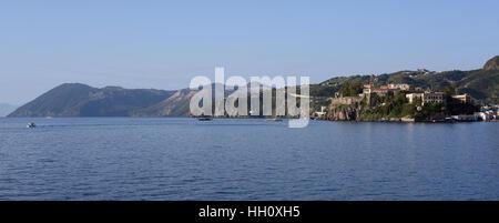 View of Lipari harbour with Vulcano behind, Aeolian Isands - Stock Photo
