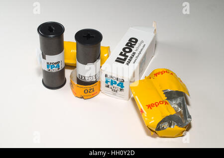 Rolls of 120 film used in medium format cameras Ilford and Kodak - Stock Photo