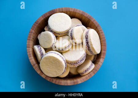 A bowl of freshly baked Alfajor cookies - Stock Photo