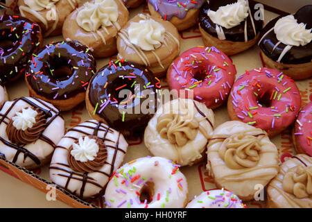 Sugar coated colorful doughnuts - Stock Photo