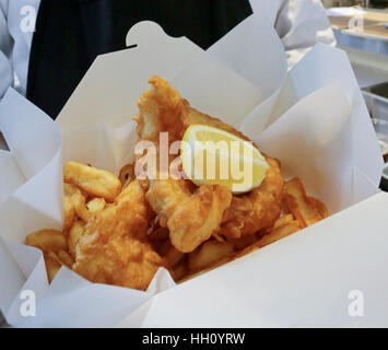 Fish and chips snack in cardboard box - Stock Photo