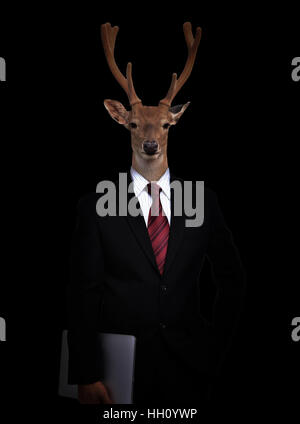 business man with deer head in the dark - Stock Photo