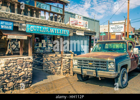 Modern Wild West scenery in Oatman Arizona with tourist shops and old rusty pickup car in Oatman. Picture in Vintage - Stock Photo