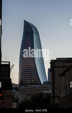 Baku, Azerbaijan - October 2, 2016: Flame towers in the cityscape. View from old town. Panoramic view of Baku - - Stock Photo